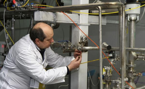 An International Atomic Energy Agency inspector cuts a uranium enrichment connection at Iran's Natanz facility, 200 miles south of  Tehran, in 2014. This week's nuclear deal gives the IAEA up to 150 inspectors to monitor Iran for compliance.
