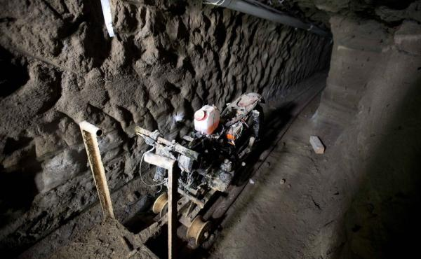 A motorcycle adapted to a rail sits in the tunnel under the house where, according to authorities, drug lord Joaquín