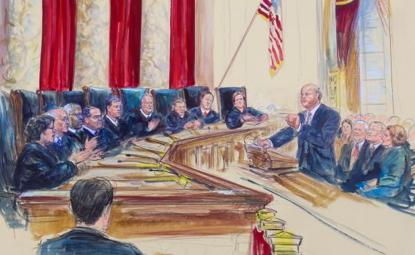 Michael Carvin (right), lead attorney for the petitioners speaking before the Supreme Court in Washington, D.C., on March 4. The justices heard arguments in King v. Burwell.