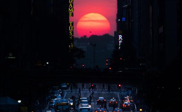The sun sets along 42nd Street in Manhattan in 2013 during a semi-annual phenomenon known as