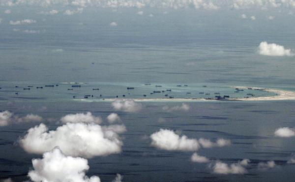 A photo taken days ago shows alleged on-going reclamation by China of Mischief Reef in the Spratly Islands in the South China Sea.