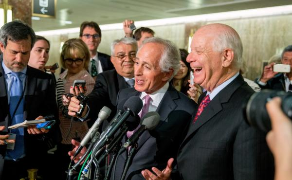 Senate Foreign Relations Committee Chairman Sen. Bob Corker, R-Tenn., center, and the committee's ranking member Sen. Ben Cardin, D-Md., right, were all smiles April 14 after the committee passed an agreement on oversight of Iran negotiations. But the bil