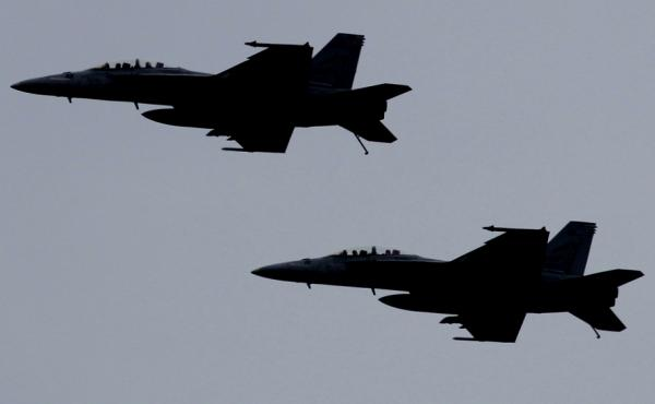 U.S. F-18 fighter jets fly over the Nimitz-class aircraft carrier USS Abraham Lincoln (CVN 72) during fly exercises in the Persian Gulf. A pair of this same type of aircraft landed in Taiwan, reportedly with mechanical problems.