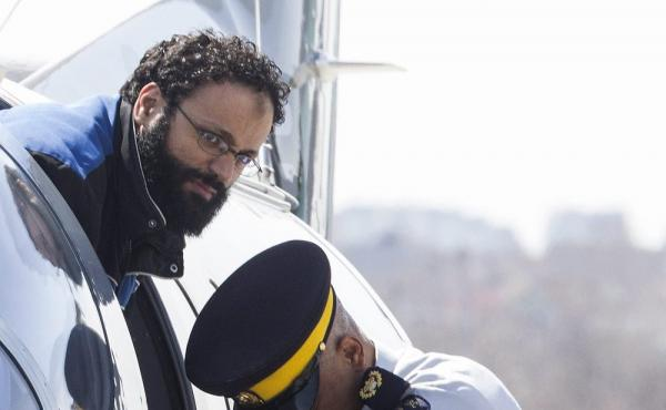 Chiheb Esseghaier, one of two men convicted of plotting a terror attack on passenger train, is led off a plane by an Royal Canadian Mounted Police officer in Toronto in 2013.