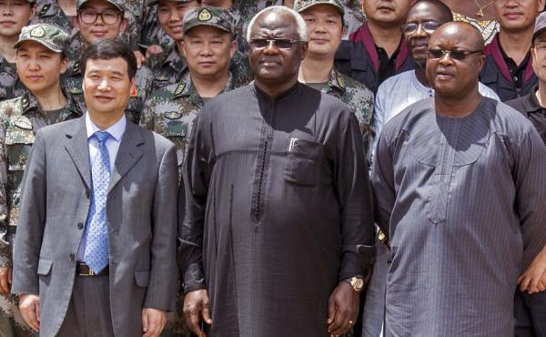 Sierra's Vice President Samuel Sam-Sumana (right) is in charge while President Ernest Bai Koroma (center) is in Europe.