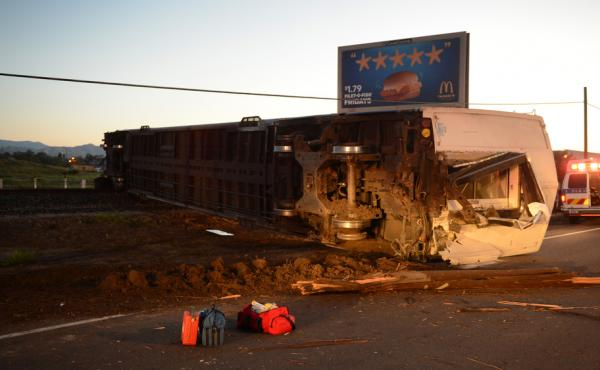An overturned Metrolink passenger car sits on the side of the road after the commuter train crashed into a truck and derailed early Tuesday near Oxnard, Calif.