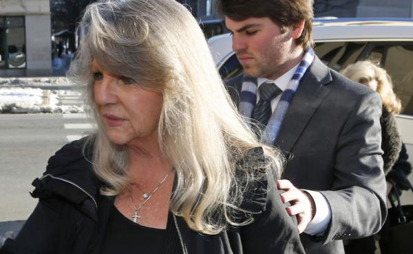 Former Virginia first lady Maureen McDonnell (left) arrives at federal court in Richmond, Va., with her son Bobby for her sentencing on corruption charges Friday.