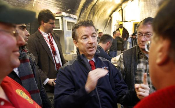 Sen. Rand Paul, R-Ky., center, meets with members of the Londonderry Fish and Game Club in Litchfield, N.H., on Jan. 14. Paul was one of three GOP presidential hopefuls who attended Sunday's semiannual gathering of David and Charles Koch's donor network i