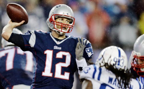 A deflated football would have been easier for New England Patriots quarterback Tom Brady (12) to grip in Sunday's rain.