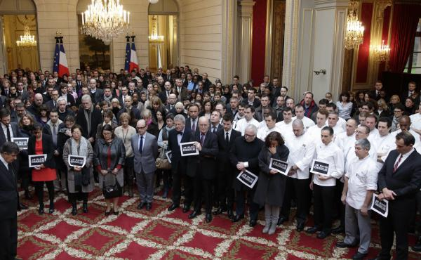 General Secretary of the Elysee Palace Jean-Pierre Jouyet, head bowed foreground at left, and the Elysee Palace staff observe a minute of silence on Thursday for victims of the shooting at the satirical newspaper Charlie Hebdo, in Paris on Wednesday.