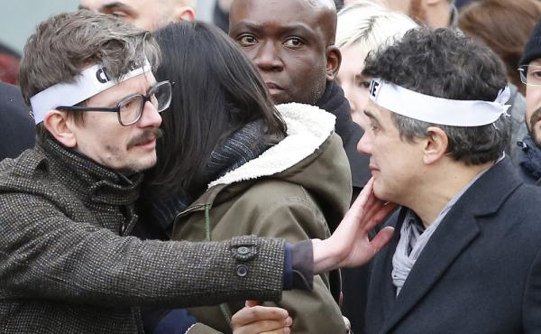 Charlie Hebdo editorialist Patrick Pelloux (right) and cartoonist Renald Luzier, known as Luz (left), join a march in Paris on Sunday.