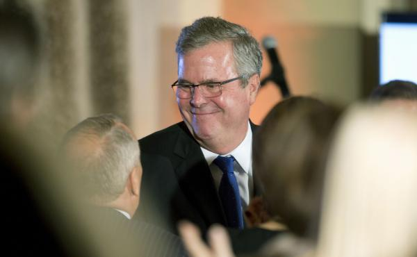 Former Florida Gov. Jeb Bush talks to supporters after speaking at the U.S. Cuba Democracy PAC's annual luncheon in Coral Gables, Fla., on Dec. 2.