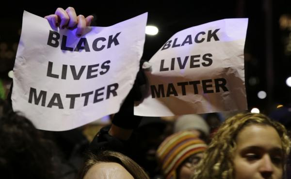 Protesters in Boston during a December demonstration against the deaths of two unarmed black men at the hands of white police officers in New York City and Ferguson, Mo.