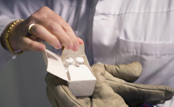 A shipment of experimental Ebola vaccine is opened at a hospital in Geneva.