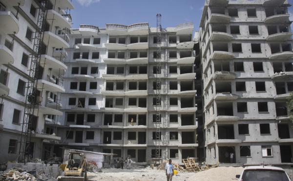 A Somali man walks in front of a high-rise apartment building under construction in Mogadishu on Nov. 4. Somalia, along with North Korea, is seen as the most-corrupt country in the world, according to the Corruption Perception Index released today by Tran