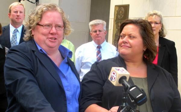 Colleen Condon, left, and her partner Nichols Bleckley appear at a news conference in Charleston, S.C., in October, shortly after filing a federal lawsuit seeking the right to marry in South Carolina. A federal judge has ruled in their favor.