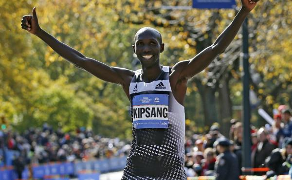 Wilson Kipsang of Kenya celebrates on the finish line after winning the men's division of the 44th annual New York City Marathon in New York on Sunday.