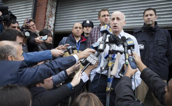 The media is all over this story: Ebola in NYC! Don Weiss, a doctor with the New York City Health Department, faces microphones outside the bowling alley visited by the physician who tested positive for the virus.