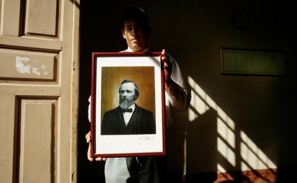 Paraguayan government employee Daniel Alonso holds a portrait of Rutherford B. Hayes at the government building in Villa Hayes, the Paraguayan town named after the 19th U.S. president. Hayes is revered for a decision that gave the country 60 percent of it