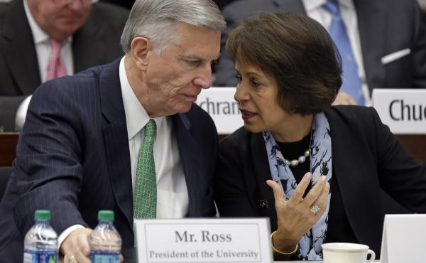 University of North Carolina system President Tom Ross and UNC Chapel Hill Chancellor Carol L. Folt talk during a special joint meeting of the UNC Board of Governors and the UNC Chapel Hill Board of Trustees on Wednesday.