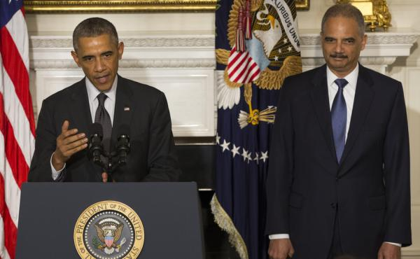 President Obama, accompanied by Attorney General Eric Holder, speaks in the State Dining Room of the White House on Thursday to announce that Holder is resigning. Holder, who served as the public face of the Obama administration's legal fight against terr