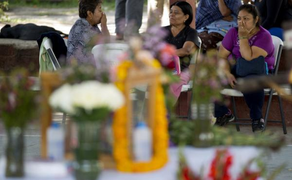 Relatives of students reported missing after a violent confrontation in Iguala with police, pass the time near a makeshift altar as they wait for news of their loved ones at the Isidro Burgos rural teachers college in Ayotzinapa, Mexico.
