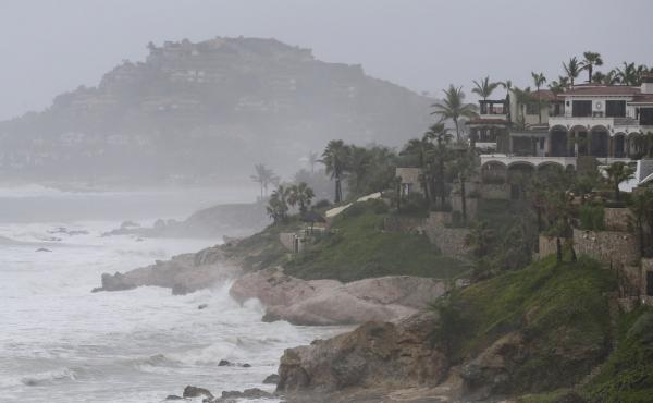 Waves hit the coast of Los Cabos, Mexico, on Sunday as Hurricane Odile nears landfall in the largely tourist area of the Baja California peninsula.