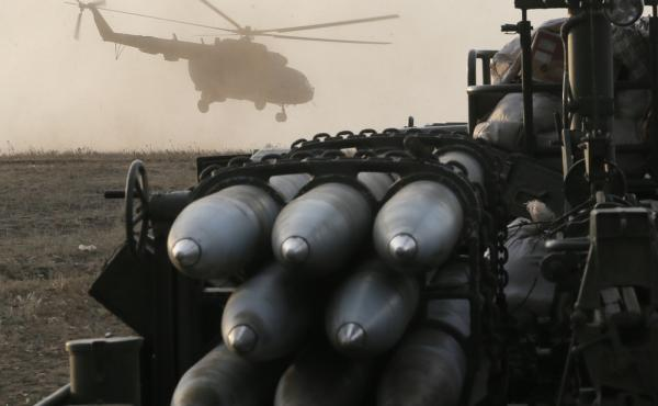 A Ukrainian army helicopter flies over troop positions Friday in Debaltsevo, in the Donetsk region of Ukraine.