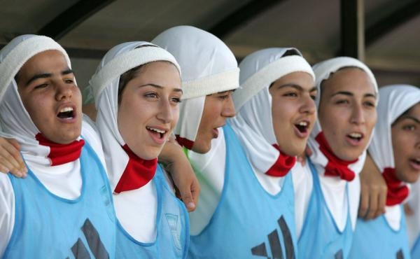 A contentious piece of clothing: Members of the Iranian women's soccer team celebrate their win over Syria back in 2007. That year, the international soccer league FIFA banned the wearing of hijabs during games. The ban was lifted in July.