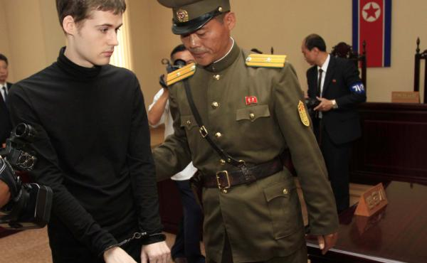 Matthew Miller leaves after his trial at North Korea's Supreme Court on Sunday. The court sentenced the U.S. citizen to six years of hard labor for entering the country illegally and trying to commit espionage.