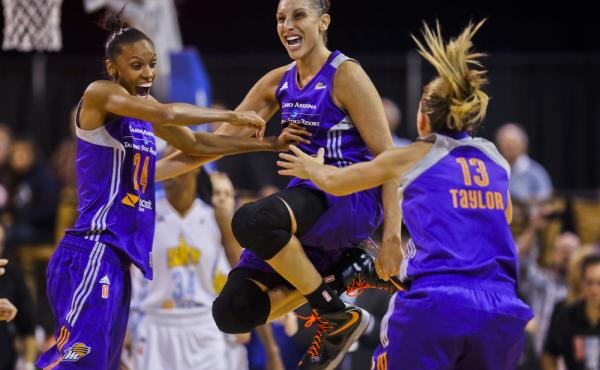 The Phoenix Mercury's Diana Taurasi celebrates the team's championship win Friday with DeWanna Bonner (24) and Penny Taylor (13), after beating the Chicago Sky in Game 3 of the WNBA Finals.