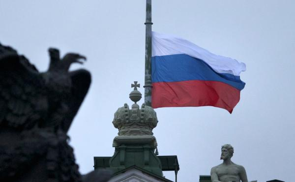A Russian national flag flies at half staff at Dvortsovaya Square in St.Petersburg, Russia, on Monday.