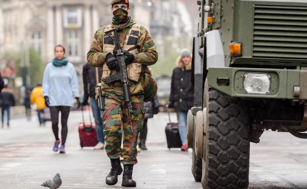 A Belgian Army soldier patrols on a main boulevard in Brussels on Sunday.