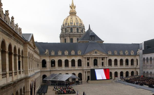 French President Francois Hollande delivers a speech honoring victims of the Paris attacks during a ceremony at the Invalides in Paris on Friday. The names of each of the 130 people killed in the attacks two weeks ago was read aloud.