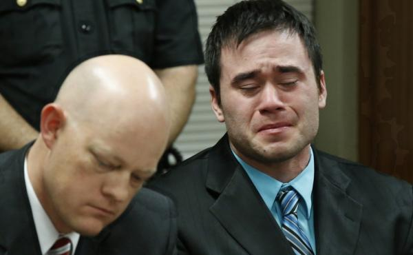Fired police officer Daniel Holtzclaw cries as guilty verdicts are read in an Oklahoma City court Thursday. Holtzclaw could face life in prison when he's sentenced for rape and other charges next month.