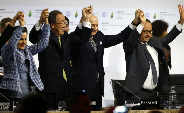French President Francois Hollande, right, French Foreign Minister and president of the COP21 meetings Laurent Fabius, second right, UN climate chief Christiana Figueres, left, and UN Secretary-General Ban ki-Moon join hands after the final adoption of an