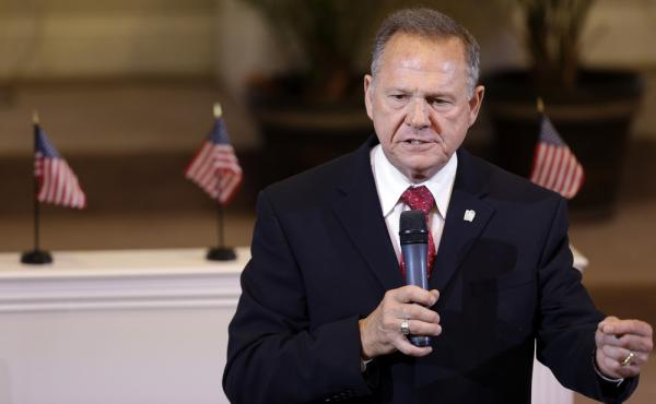 Alabama Supreme Court Chief Justice Roy S. Moore speaks to the congregation of Kimberly Church of God in Kimberley, Ala., in June.
