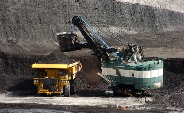 The federal government will stop issuing new coal leases on some 570 million acres of federal land, under a new plan being released Friday. In this photo from 2013, coal is loaded onto a truck at a mine built on federally controlled land in Montana.