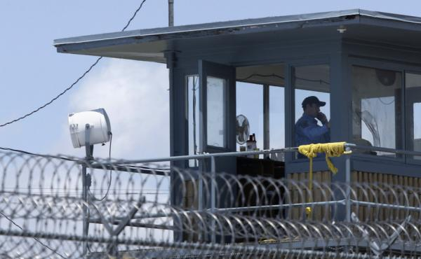 A guard stands watch in a tower at the Arkansas Department of Corrections Tucker Unit near Tucker, Ark.