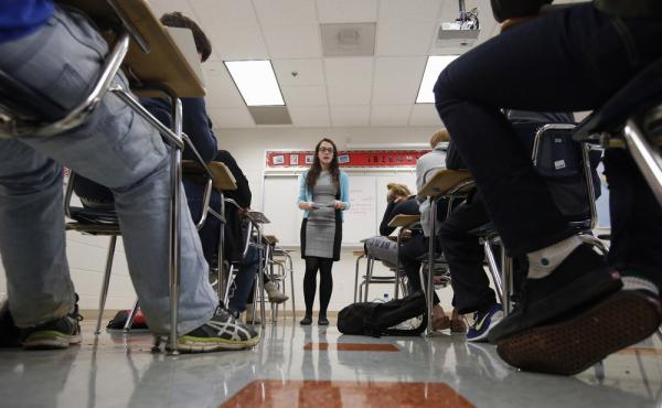 Katerina Maylock teaches a college test preparation class at Holton Arms School in Bethesda, Md. The current version of the SAT college entrance exam is having its final run, when thousands of students nationwide will sit, squirm or stress through the nea