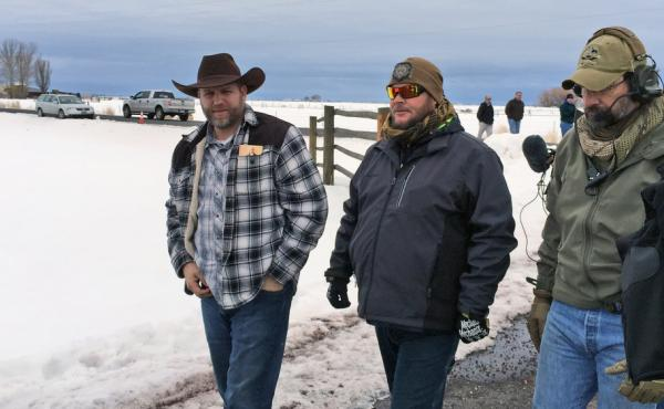 Ammon Bundy, left, approaches an FBI gate at the Burns Municipal Airport in Oregon on Friday. Bundy, the leader of an armed group occupying a national wildlife refuge to protest federal land policies, was among seven arrested on Tuesday. An eighth member