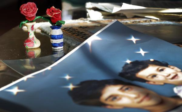 On Dec. 10, 2014, prison artwork created by Adnan Syed sits near family photos in the Baltimore home of his mother, Shamim Syed. Syed, convicted in 2000 of murdering his girlfriend, is appearing at a hearing Wednesday to request a new trial, based on evid