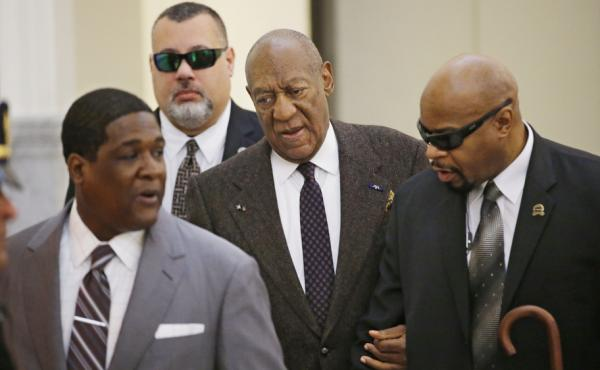 Bill Cosby arrives for a court appearance Wednesday in Norristown, Pa. The judge has ruled that the case against him will proceed, despite a claim that he was promised immunity a decade ago.
