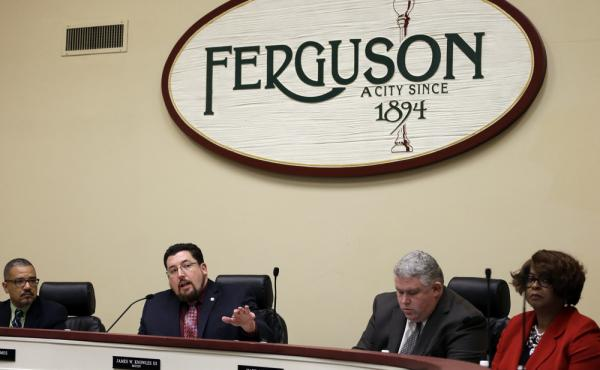 Ferguson mayor James Knowles III, (second from left) speaks during a city council meeting on Feb. 2. The meeting was the first opportunity for residents to speak directly with city leaders about the preliminary consent agreement with the U.S. Department o