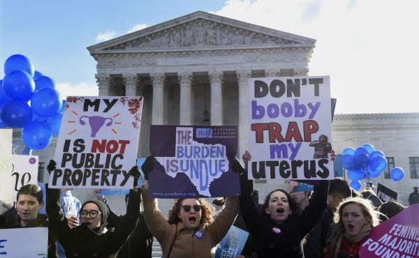 Abortion rights protesters rally outside the Supreme Court in Washington on Wednesday.