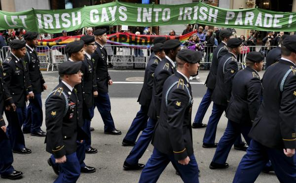 Marchers walk past a group of protesters during the St. Patrick's Day parade in New York last year.