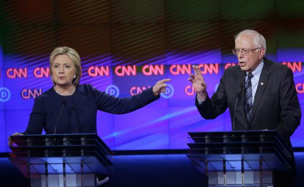 Hillary Clinton and Sen. Bernie Sanders debate  a point during a Democratic presidential primary debate at the University of Michigan-Flint on Sunday.