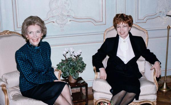 Nancy Reagan, left, and the Soviet First Lady, Raisa Gorbachev, both smile politely during a tension-filled tea in Geneva in 1985, while their husbands discussed nuclear disarmament.