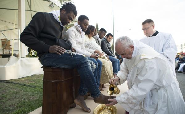 Pope Francis washes the foot of a refugee during a ritual at the Castelnuovo di Porto refugees center outside Rome on Thursday.