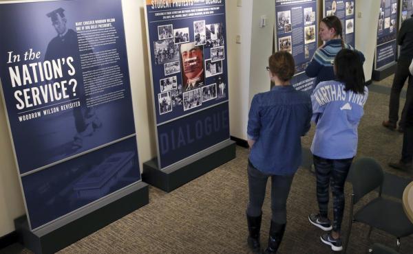 Princeton University students walk through an exhibit titled